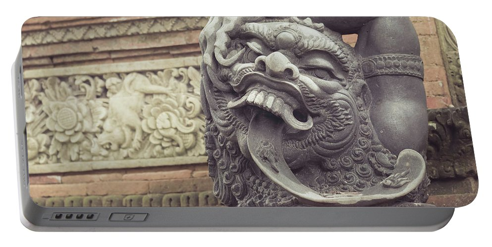 Sculpture Portable Battery Charger featuring the photograph Bali Sculpture by Jijo George