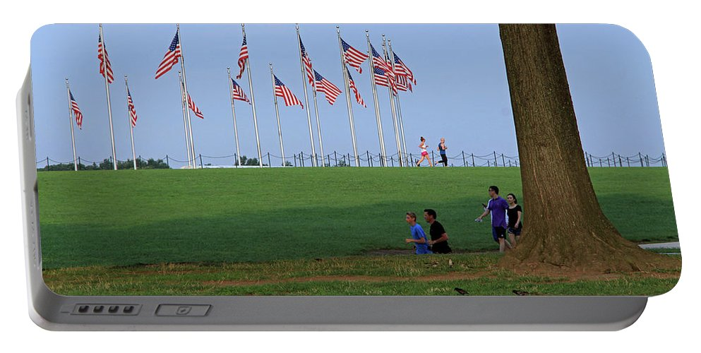 American Portable Battery Charger featuring the photograph 17 Flags 7 People 1 Tree Trunk by Cora Wandel