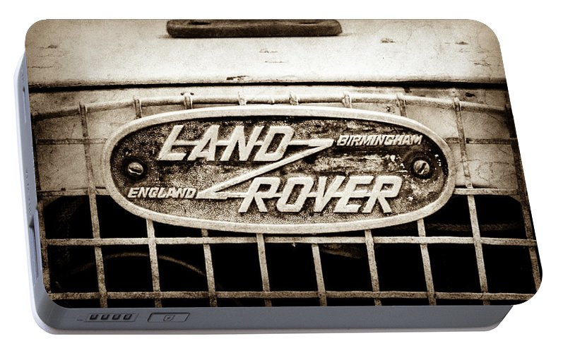 1952 Land Rover 80 Grille Emblem Portable Battery Charger featuring the photograph 1952 Land Rover 80 Grille Emblem -0988s2 by Jill Reger