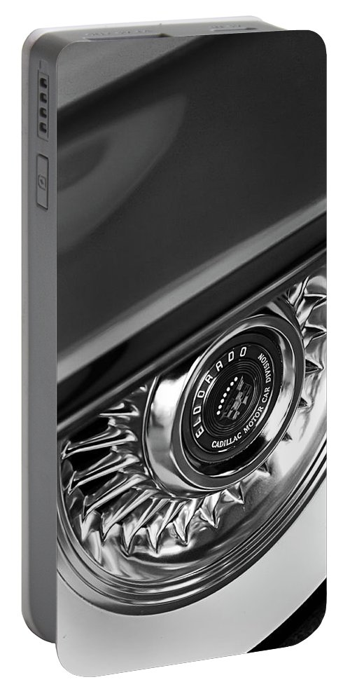 Car Portable Battery Charger featuring the photograph 1956 Cadillac Eldorado Wheel Black And White by Jill Reger