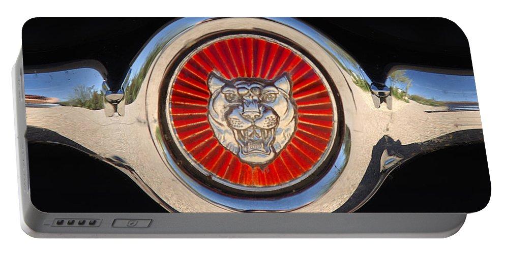 Transportation Portable Battery Charger featuring the photograph 1963 Jaguar Xke Roadster Emblem by Jill Reger