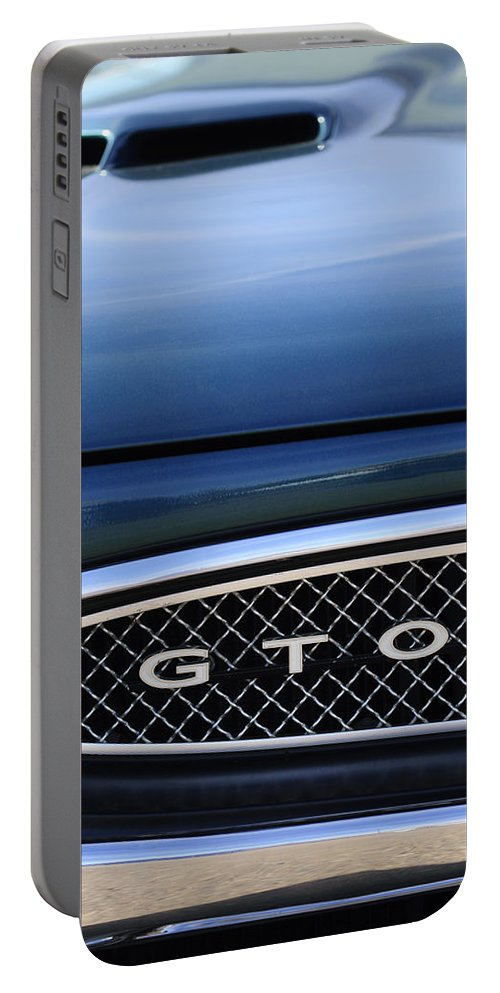 1967 Pontiac Gto Portable Battery Charger featuring the photograph 1967 Pontiac Gto Grille Emblem by Jill Reger