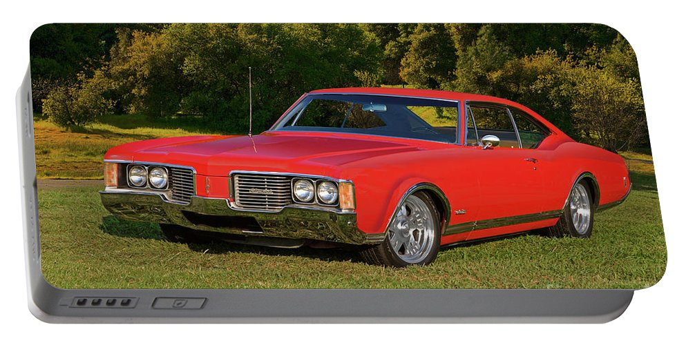 Automobile Portable Battery Charger featuring the photograph 1968 Oldsmobile Delta 88 by Dave Koontz