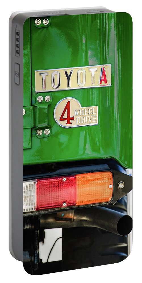 1982 Toyota Fj43 Land Cruiser Tail Light Emblem Portable Battery Charger featuring the photograph 1982 Toyota Fj43 Land Cruiser Tail Light Emblem -0483g by Jill Reger