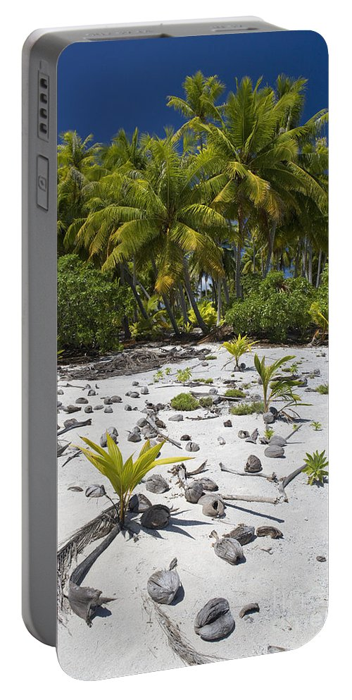 Coconut Portable Battery Charger featuring the photograph Coconut Palms On A Polynesian Beach by Jean-Louis Klein & Marie-Luce Hubert