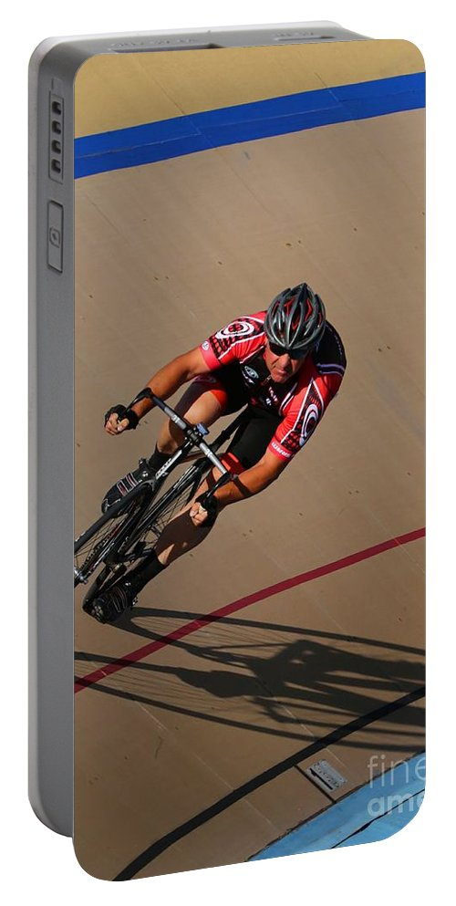 Pursuit Portable Battery Charger featuring the photograph Cycle Racing On The Curve by Douglas Sacha