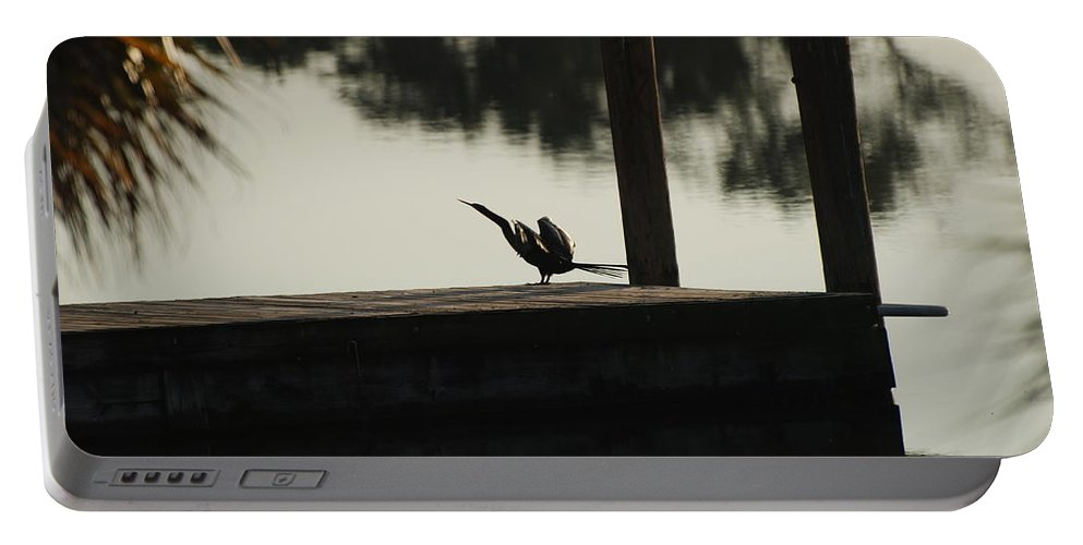 Reflections Portable Battery Charger featuring the photograph Dock Bird by Rob Hans
