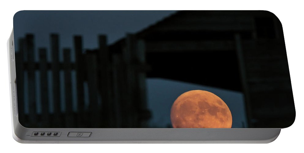 Full Moon Portable Battery Charger featuring the digital art Full Moon Seen Through Old Building Window by Mark Duffy
