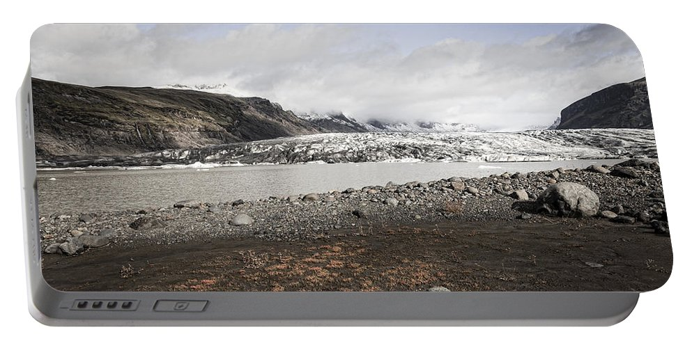 Europe Portable Battery Charger featuring the photograph Glacier Lagoon by Alexey Stiop