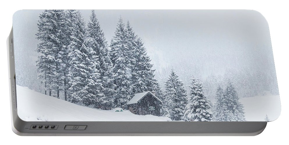 Horizontal Portable Battery Charger featuring the photograph Huts And Winter Landscapes by Travel and Destinations - By Mike Clegg