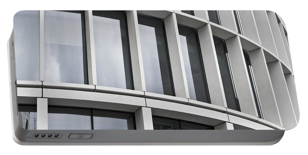 Abstract Portable Battery Charger featuring the photograph Modern Office Building by Tom Gowanlock