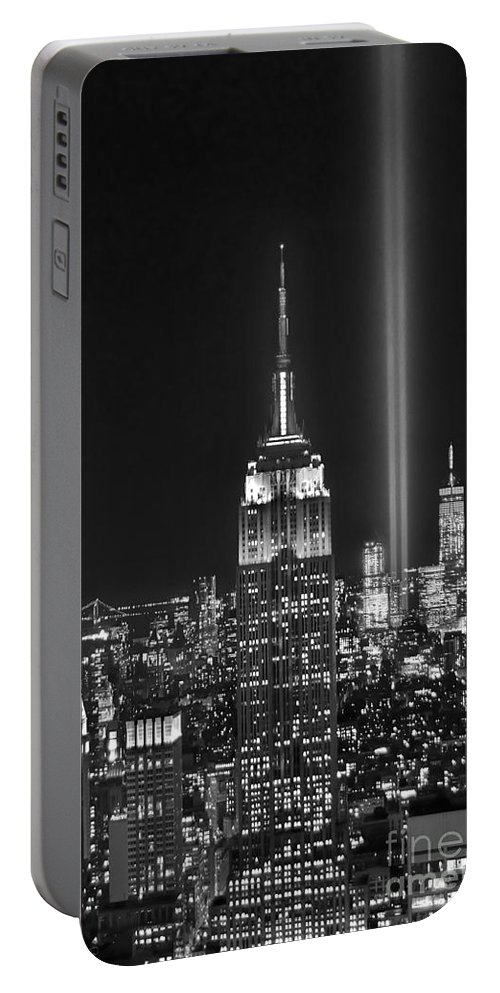 New York City Skyline At Night Portable Battery Charger featuring the photograph New York City Tribute in Lights Empire State Building Manhattan at Night NYC by Jon Holiday