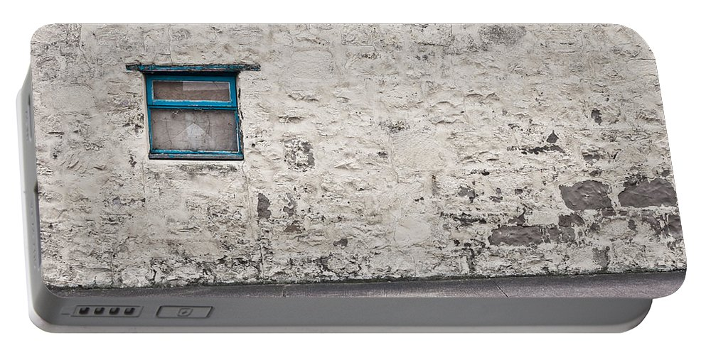 Antique Portable Battery Charger featuring the photograph Old Wall by Tom Gowanlock