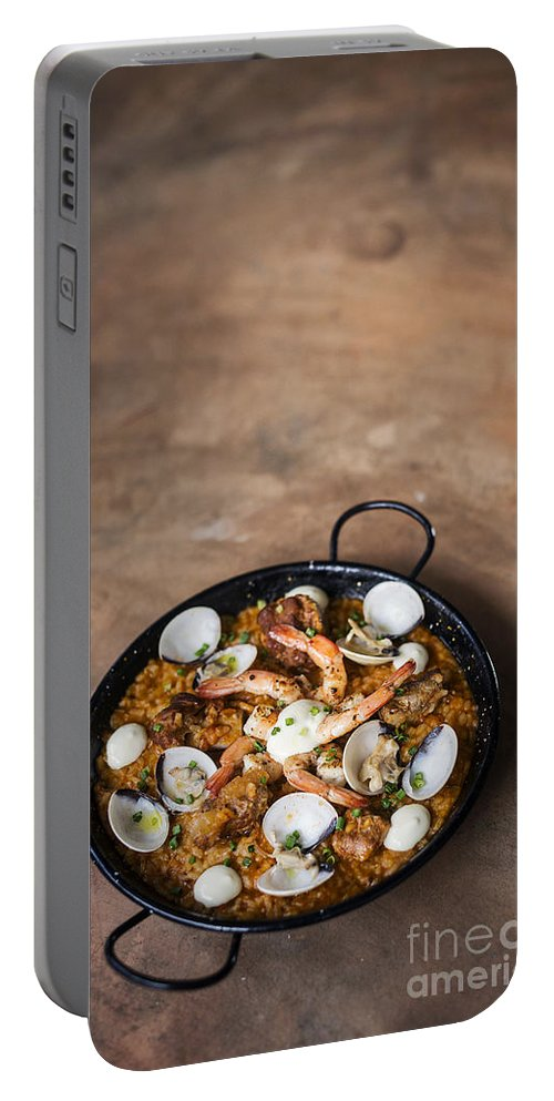 Cuisine Portable Battery Charger featuring the photograph Seafood And Rice Paella Traditional Spanish Food by Jacek Malipan