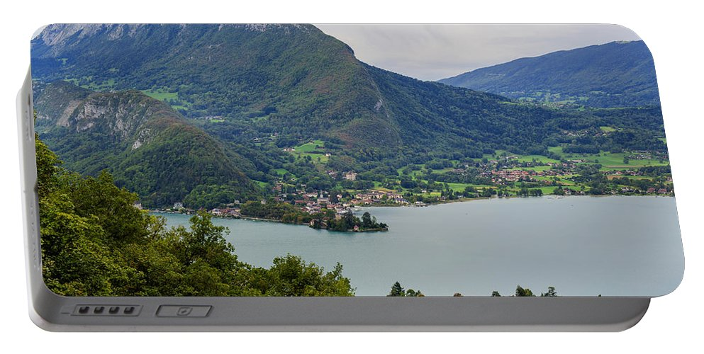 Village Of Talloires On The Banks Of Lake Annecy Portable Battery Charger featuring the photograph Village Of Talloires On The Banks Of Lake Annecy by Yefim Bam