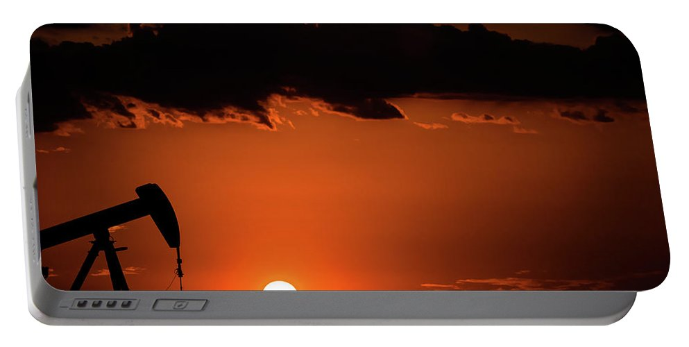 Drillers Club Portable Battery Charger featuring the photograph 2017_08_midkiff Tx_sunset Pump Jack 2 by Brian Farmer