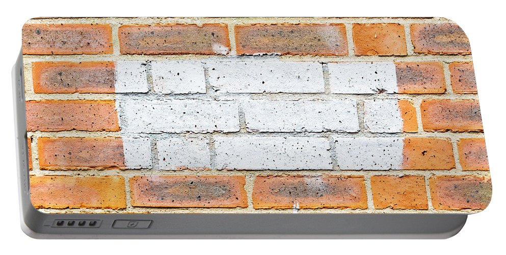Aging Portable Battery Charger featuring the photograph Brick Wall by Tom Gowanlock