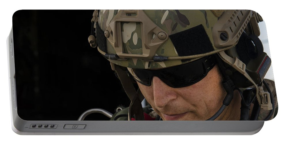 Exercise Emerald Warrior Portable Battery Charger featuring the photograph A U.s. Air Force Combat Controller by Stocktrek Images