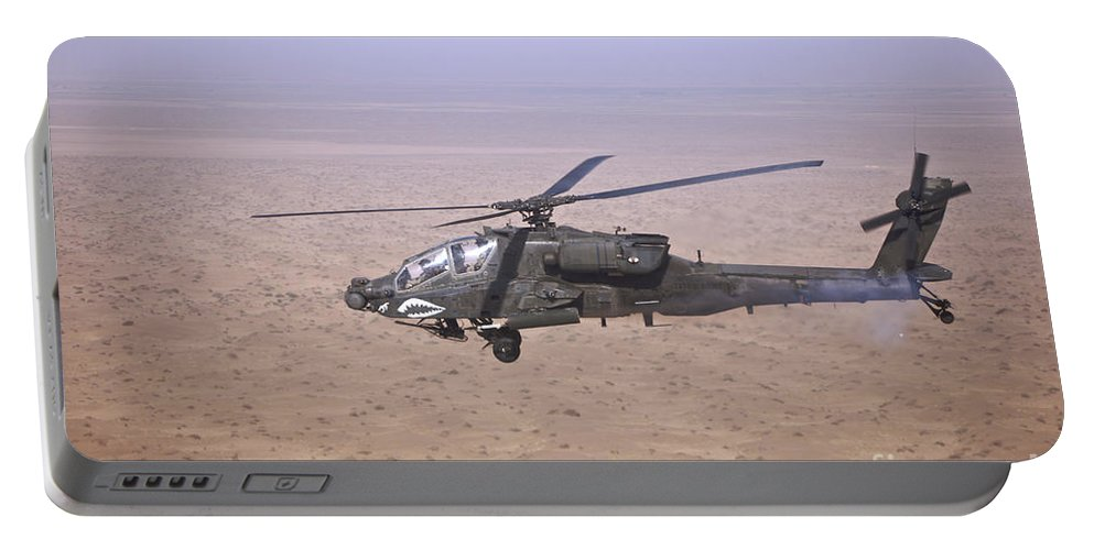 Ah-64 Portable Battery Charger featuring the photograph An Ah-64d Apache Longbow Fires A Hydra by Terry Moore