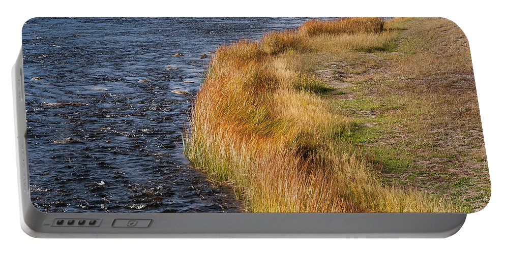 Firehole River Portable Battery Charger featuring the photograph Blue And Gold by Bob Phillips