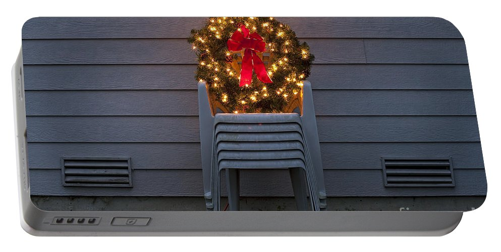 Christmas Portable Battery Charger featuring the photograph Christmas Wreath On Lawn Chairs by Jim Corwin