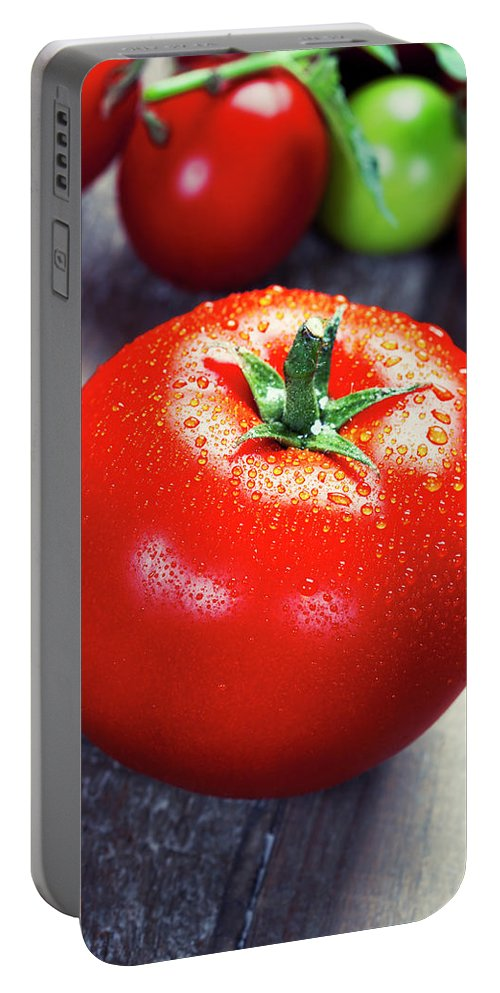 Appetite Portable Battery Charger featuring the photograph Fresh Tomatoes by Natalia Klenova