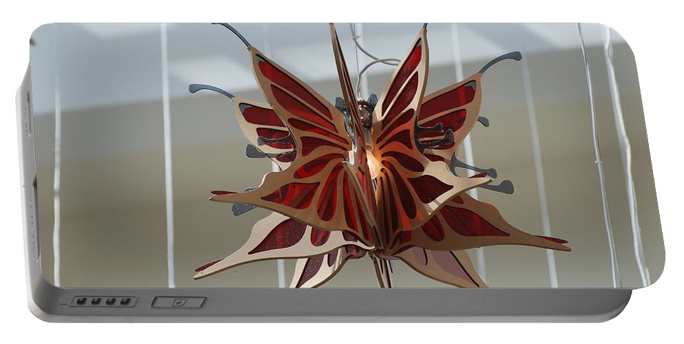 Architecture Portable Battery Charger featuring the photograph Hanging Butterfly by Rob Hans