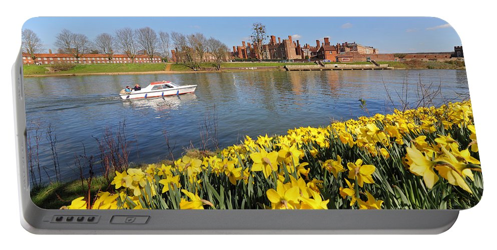 Daffodils Beside The Thames At Hampton Court London Uk Portable Battery Charger featuring the photograph Daffodils Beside The Thames At Hampton Court London Uk by Julia Gavin