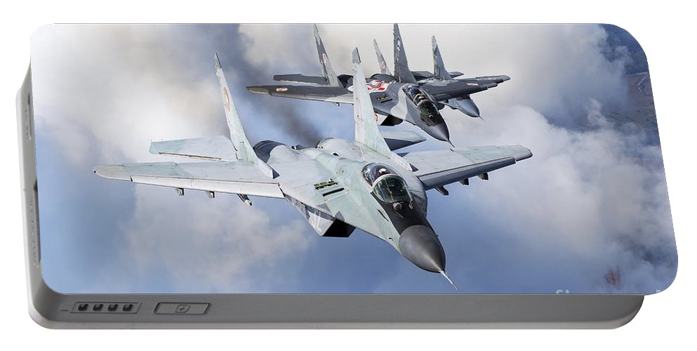 Horizontal Portable Battery Charger featuring the photograph Bulgarian And Polish Air Force Mig-29s by Daniele Faccioli
