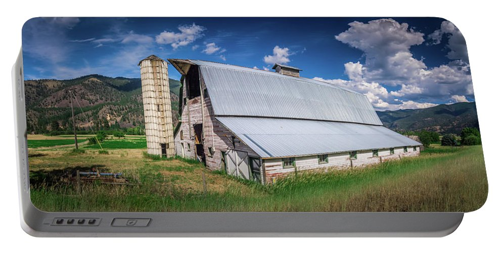 Summer Portable Battery Charger featuring the photograph Summer Sunset With A Red Barn In Rural Montana And Rocky Mountai by Alex Grichenko