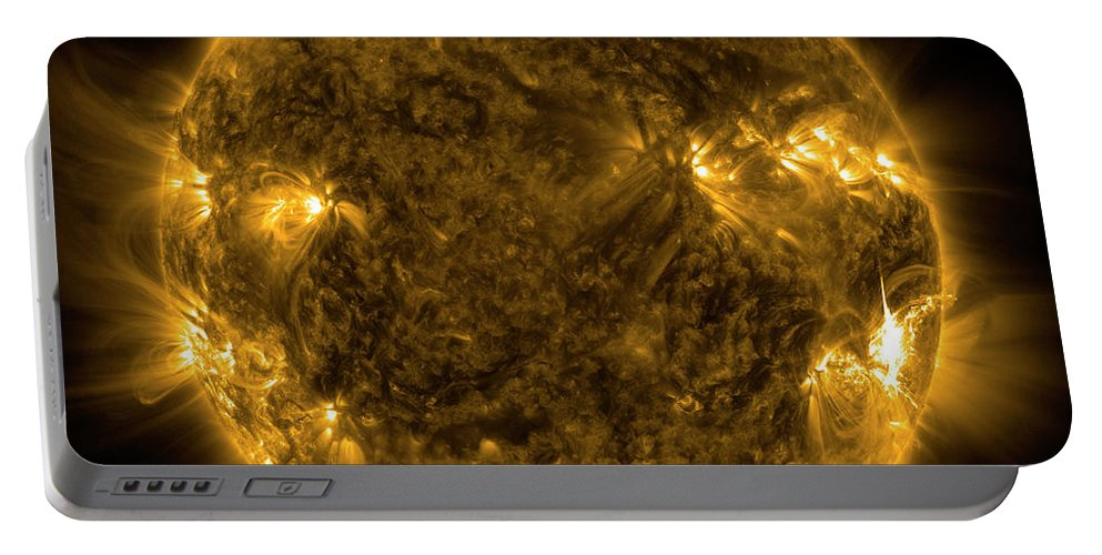 Color Image Portable Battery Charger featuring the photograph Solar Activity On The Sun by Stocktrek Images