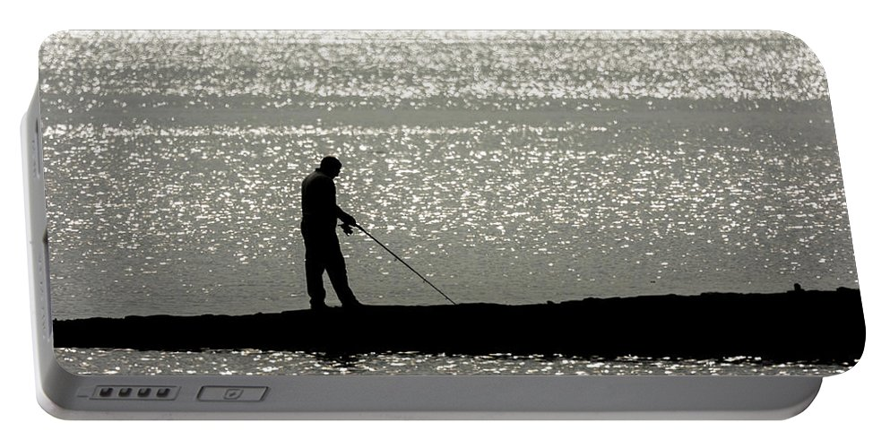 Portable Battery Charger featuring the photograph 78. One Man And His Rod by Daron Lomax