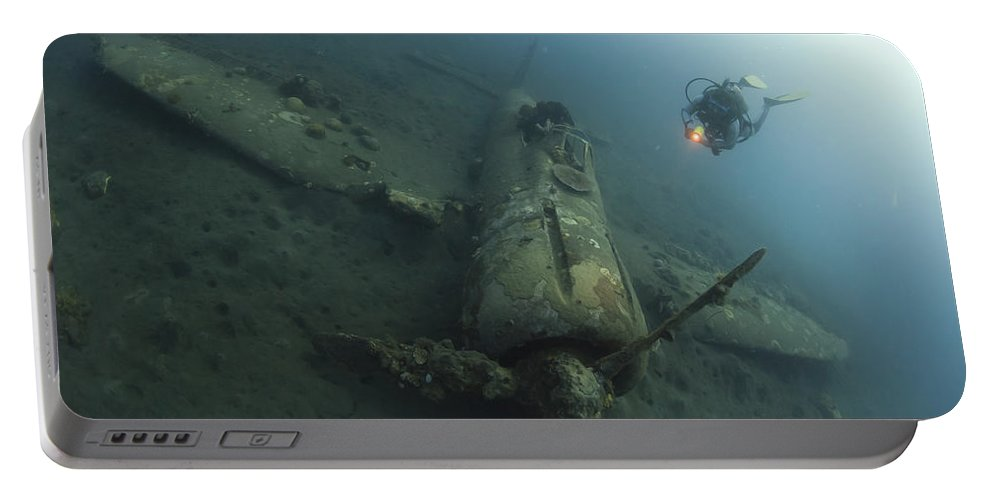 Kimbe Bay Portable Battery Charger featuring the photograph Diver Explores The Wreck by Steve Jones