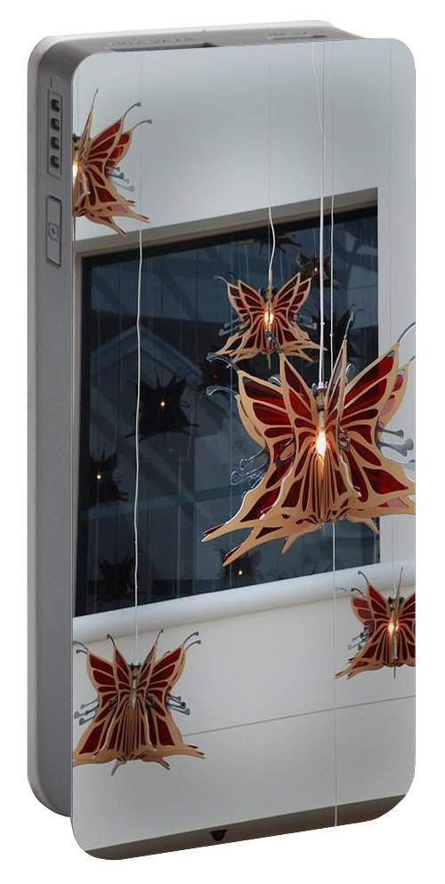 Architecture Portable Battery Charger featuring the photograph Hanging Butterflies by Rob Hans