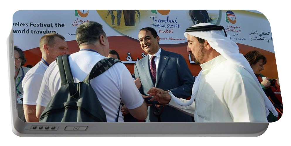 Portable Battery Charger featuring the photograph Dubai Travelers Festival by Mohamed Dekkak