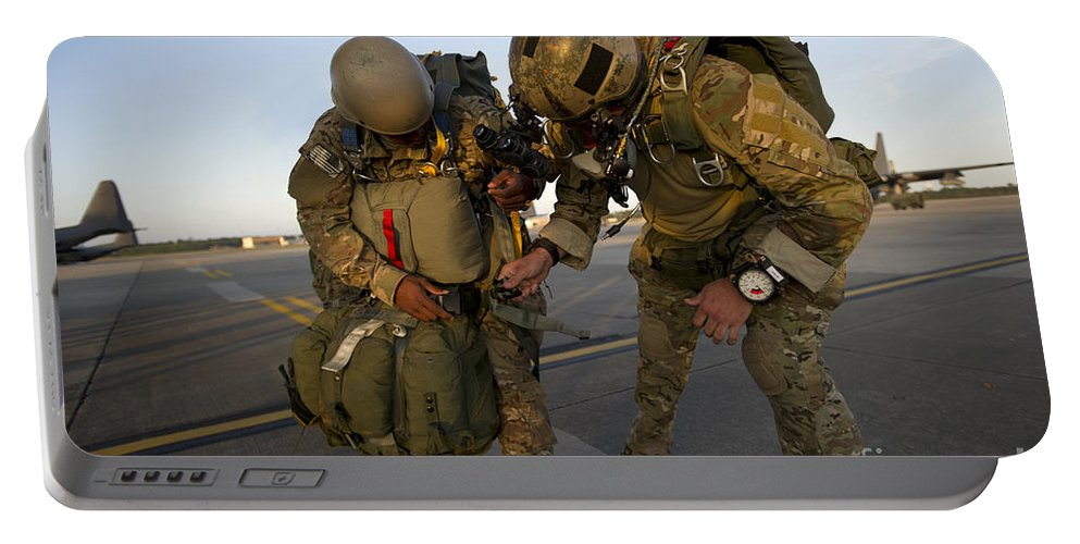 Soldier Portable Battery Charger featuring the photograph A Green Beret Inspects The Gear by Stocktrek Images