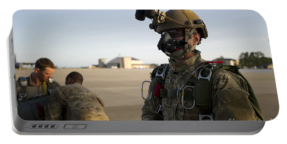 Soldier Portable Battery Charger featuring the photograph A Green Beret Waits To Have His Gear by Stocktrek Images