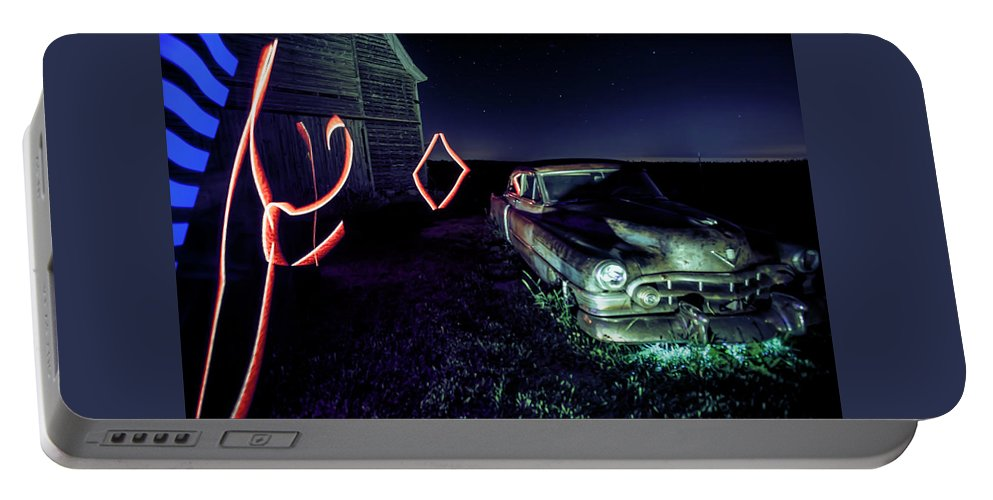 Rusty Car Portable Battery Charger featuring the photograph A Light Painted Scene Of A Rusty Caddy By A Barn And Cornfield by Sven Brogren
