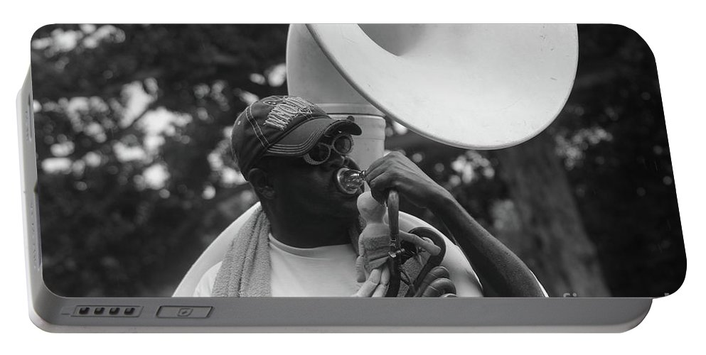 Black And White Portable Battery Charger featuring the photograph A Man Blows His Horn by Michelle Powell
