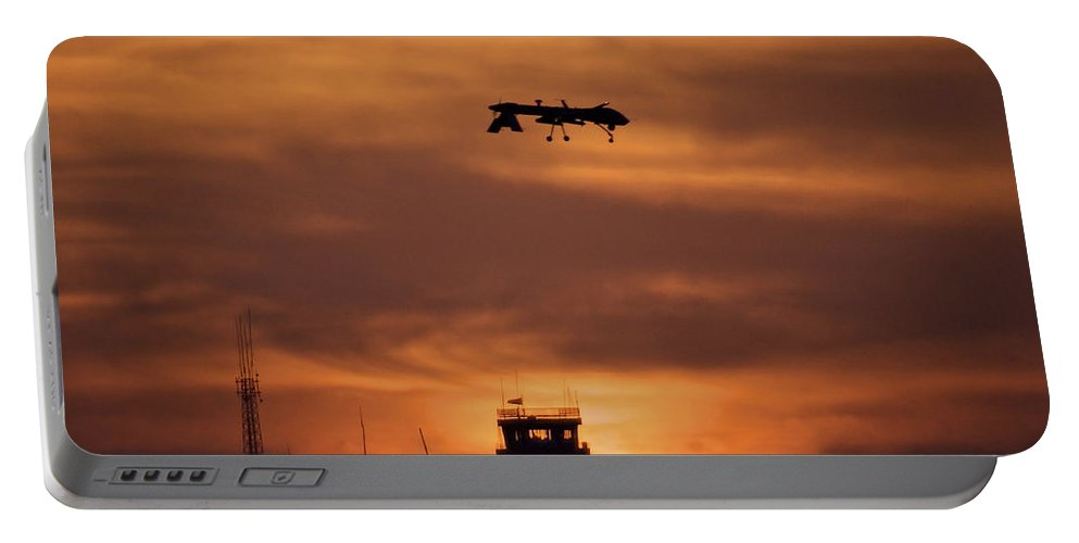 Airfield Portable Battery Charger featuring the photograph A Mq-1 Predator Over Cob Speicher by Terry Moore