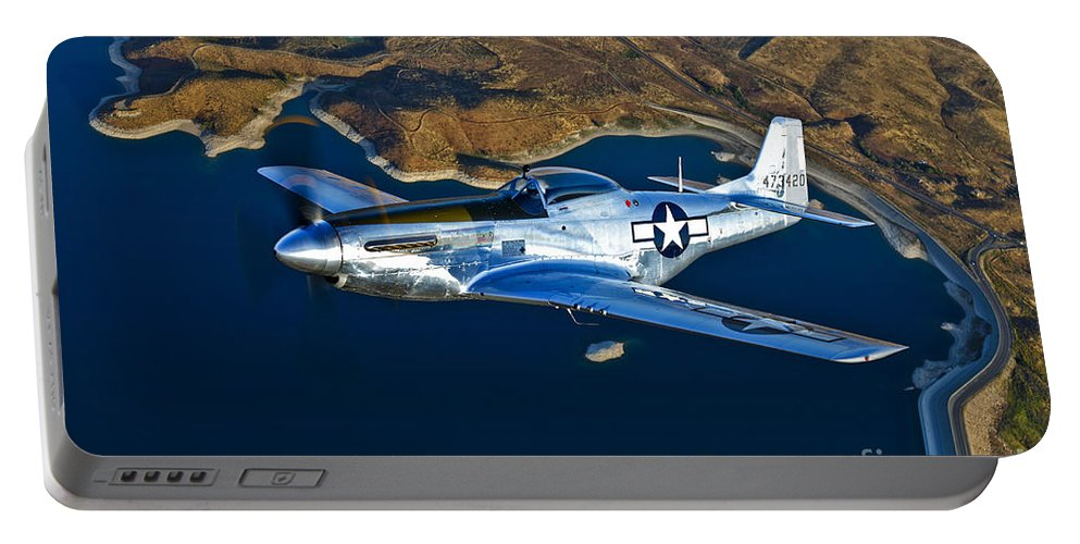 Horizontal Portable Battery Charger featuring the photograph A North American P-51d Mustang Flying by Scott Germain