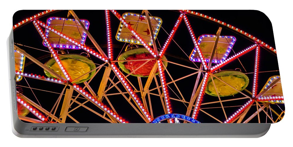 Carousel Portable Battery Charger featuring the photograph A Ride In The Carousel by Wolfgang Stocker