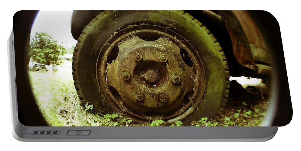 Art Portable Battery Charger featuring the photograph A Rolling Tire Gathers No Moss by Clayton Bruster