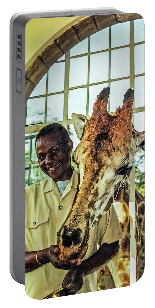 Rothchild's Giraffe Portable Battery Charger featuring the photograph A Rothchild's Giraffe Munching Horse Pellets Through An Open Window by Elizabeth Hershkowitz