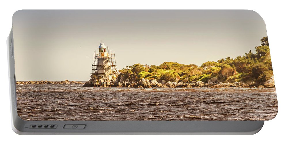 Light House Portable Battery Charger featuring the photograph A Seashore Construction by Jorgo Photography - Wall Art Gallery