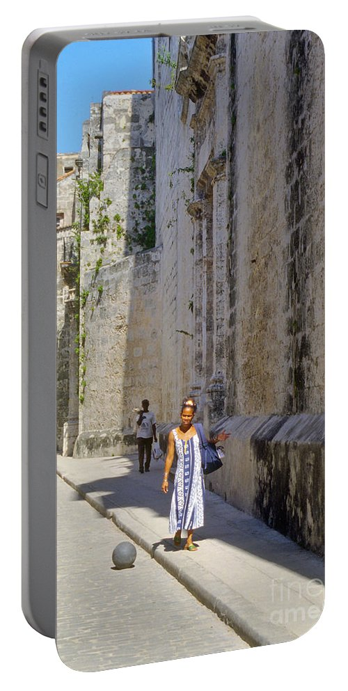 Havana Cuba City Cities Cityscape Cityscapes Woman Street Streets Women Person Persons People Creature Creature Cobblestone Cobblestones Portable Battery Charger featuring the photograph A Stroll By The Cathedral by Bob Phillips