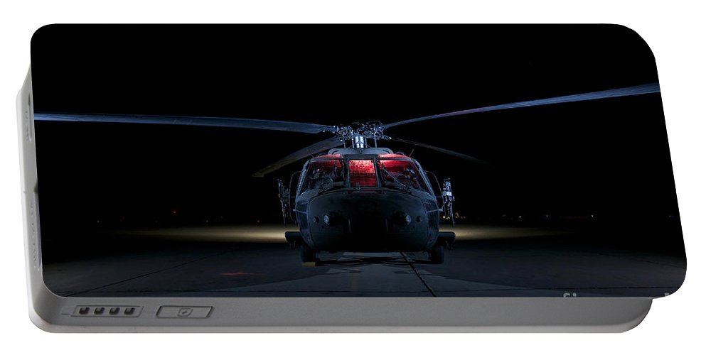 Operation Iraqi Freedom Portable Battery Charger featuring the photograph A Uh-60 Black Hawk Helicopter Lit by Terry Moore