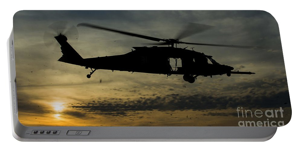 Exercise Emerald Warrior Portable Battery Charger featuring the photograph A U.s. Army Uh-60 Black Hawk Leaves by Stocktrek Images