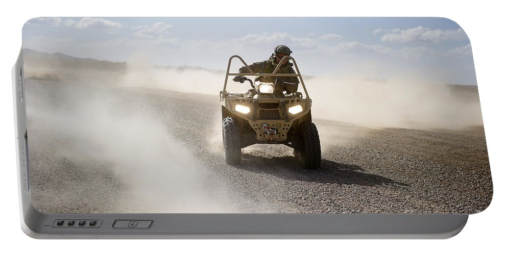 Soldier Portable Battery Charger featuring the photograph A U.s. Soldier Performs Off-road by Stocktrek Images