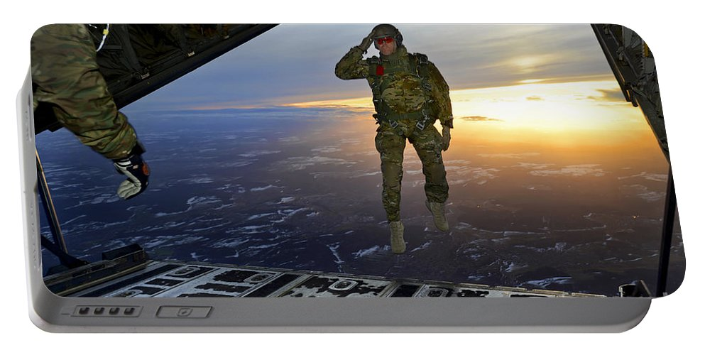 C-130 Portable Battery Charger featuring the photograph A U.s. Soldier Salutes His Fellow by Stocktrek Images